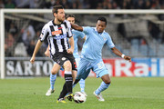 Andrea Lazzari  (L) of Udinese Calcio competes with Eddy Onazi  of S.S. Lazio during the Serie A match between Udinese Calcio and S.S. Lazio at Stadio Friuli on April 20, 2013 in Udine, Italy.