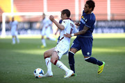 Roberto Pereyra (R) of Udinese Calcio competes with  Djamel Mesbah of Livorno Calcio during the Serie A match between Udinese Calcio and AS Livorno Calcio at Stadio Friuli on May 4, 2014 in Udine, Italy.