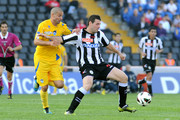 Andrea Lazzari (R) of Udinese competes with Manuele Blasi of Pescara  during the Serie A match between Udinese Calcio and Pescara at Stadio Friuli on October 21, 2012 in Udine, Italy.