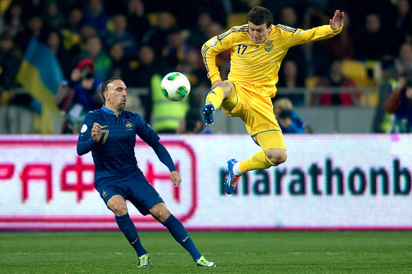 Artem Fedetskiy of Ukraine (R) fights for the ball with Franck Ribery of France (L) during the FIFA 2014 World Cup Qualifier Play-off First Leg between Ukraine and France at the Olympic Stadium on November 15, 2013 in Kiev, Ukraine.
