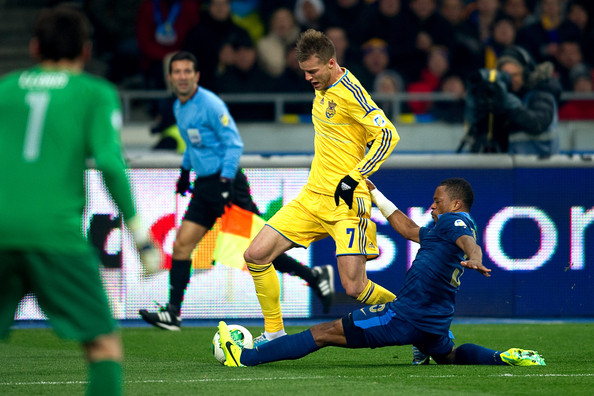 Andriy Yarmolenko of Ukraine (L) fights for the ball with Patrice Evra of France (R) during the FIFA 2014 World Cup Qualifier Play-off First Leg between Ukraine and France at the Olympic Stadium on November 15, 2013 in Kiev, Ukraine.