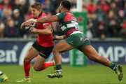 Jacob Stockdale of Ulster is held by Manu Tuilagi during the Champions Cup match between Ulster Rugby and Leicester Tigers at the Kingspan Stadium on October 13, 2018 in Belfast, United Kingdom.