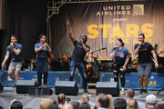 "Andre Ward and the cast of ""Escape tp Margaritaville"" perform at the United Airlines Presents: #StarsInTheAlley Produced By The Broadway League on June 1, 2018 in New York City."