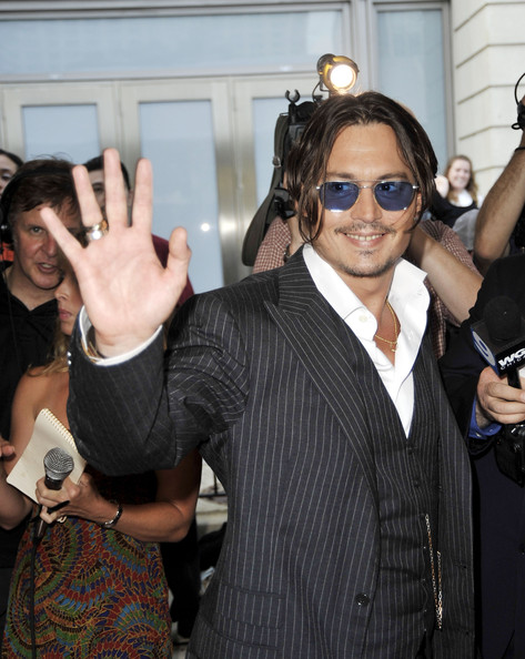 Johnny Depp Actor Johnny Depp arrives at the premiere of Universal Pictures'