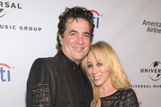 Founder of Big Machine Records Scott Borchetta (L) and Sandi Spika Borchetta attend Universal Music Group 2016 Grammy After Party presented by American Airlines and Citi at The Theatre at Ace Hotel Downtown LA on February 15, 2016 in Los Angeles, California.