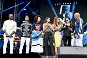 (L-R) Tyrese Gibson, Ludacris, Nathalie Emmanuel, Jordana Brewster, Maria Menounos, Michelle Rodriguez and Vin Diesel speak onstage during Universal Pictures Presents The Road To F9 Concert and Trailer Drop on January 31, 2020 in Miami, Florida.