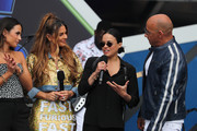 (L-R) Jordana Brewster, Michelle Rodriguez, Maria Menounos and Vin Diesel speak onstage during Universal Pictures Presents The Road To F9 Concert and Trailer Drop on January 31, 2020 in Miami, Florida.