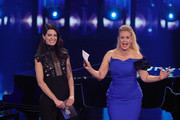 """Host Barbara Schoeneberger (R) and Linda Zervakis stand on stage during the show """"Unser Lied fuer Israel"""" at Studio Berlin Adlershof on February 22, 2019 in Berlin, Germany. The winner will represent Germany at the Eurovision Song Contest in Tel Aviv, Israel in May 2019."""