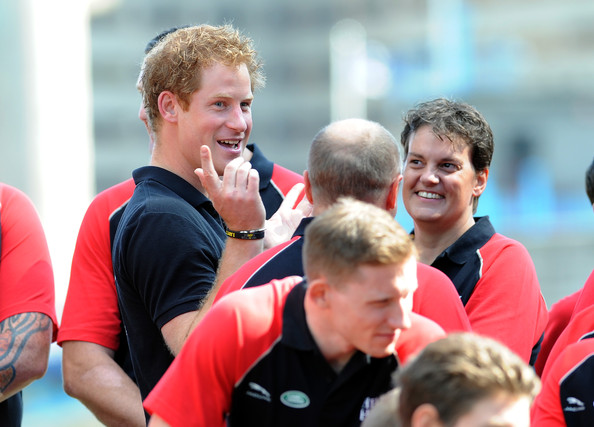 Prince Harry joins members of the British Armed Forces Team as thier unveiling For The Invictus Games at Potters Field Park on August 13, 2014 in London, England.