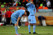 Diego Forlan and Jorge Fucile of Uruguay show their dejection after losing the 2010 FIFA World Cup South Africa Third Place Play-off match between Uruguay and Germany at The Nelson Mandela Bay Stadium on July 10, 2010 in Port Elizabeth, South Africa.