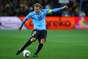 Diego Forlan of Uruguay strikes the ball during the 2010 FIFA World Cup South Africa Quarter Final match between Uruguay and Ghana at the Soccer City stadium on July 2, 2010 in Johannesburg, South Africa.