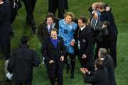 Diego Forlan of Uruguay celebrates victory after winning a penalty shoot out during the 2010 FIFA World Cup South Africa Quarter Final match between Uruguay and Ghana at the Soccer City stadium on July 2, 2010 in Johannesburg, South Africa.