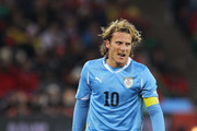 Diego Forlan of Uruguay prepares to take a free kick during the 2010 FIFA World Cup South Africa Quarter Final match between Uruguay and Ghana at the Soccer City stadium on July 2, 2010 in Johannesburg, South Africa.