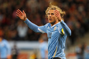 Diego Forlan of Uruguay gestures during the 2010 FIFA World Cup South Africa Semi Final match between Uruguay and the Netherlands at Green Point Stadium on July 6, 2010 in Cape Town, South Africa.