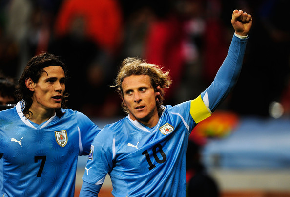 Diego Forlan Diego Forlan of Uruguay celebrates scoring his team's first goal during the 2010 FIFA World Cup South Africa Semi Final match between Uruguay and the Netherlands at Green Point Stadium on July 6, 2010 in Cape Town, South Africa.