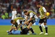 Luis Suarez of Uruguay celebrates victory with Guillermo Varela, Sebastian Coates and Giorgian De Arrascaeta during the 2018 FIFA World Cup Russia Round of 16 match between Uruguay and Portugal at Fisht Stadium on June 30, 2018 in Sochi, Russia.