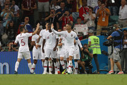 Pepe of Portugal celebrates with teammates after scoring his team's first goal during the 2018 FIFA World Cup Russia Round of 16 match between Uruguay and Portugal at Fisht Stadium on June 30, 2018 in Sochi, Russia.