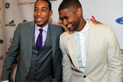 Ludacris and Usher attend the 15th Anniversary Celebration of Usher's New Look at the President's Circle Awards Luncheon on July 31, 2014 in Atlanta, Georgia.