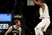 Derrick Favors #15 of the Utah Jazz dunks the ball in the third quarter against Tyler Zeller #44 of the Brooklyn Nets during their game at Barclays Center on November 17, 2017 in the Brooklyn borough of New York City. NOTE TO USER: User expressly acknowledges and agrees that, by downloading and or using this photograph, User is consenting to the terms and conditions of the Getty Images License Agreement.