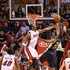 Chris Bosh Photos - Chris Bosh #1 of the Miami Heat blocks the shot of Earl Watson #11 during a game against the Utah Jazz at American Airlines Arena on November 9, 2010 in Miami, Florida. NOTE TO USER: User expressly acknowledges and agrees that, by downloading and/or using this Photograph, User is consenting to the terms and conditions of the Getty Images License Agreement. - Utah Jazz v Miami Heat