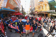 Shane van Gisbergen and Jamie Whincup of Red Bull Racing Australia pose for the media with Dakar Rally Champion Toby Price ahead of a pit stop challenge in Rundle Mall ahead of the V8 Supercars Clipsal 500 at Adelaide Street Circuit on March 2, 2016 in Adelaide, Australia.