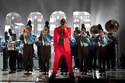 Kanye brightens up the stage in an all red suit for the GOOD Music performance in Texas.