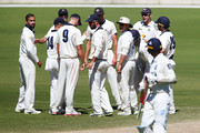 Victoria players celebrate after Trent Copeland of New South Wales was dismissed off the bowling of Fawad Ahmed of Victoria (L) during day five of the Sheffield Shield match between Victoria and New South Wales at Junction Oval on March 6, 2018 in Melbourne, Australia.