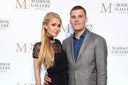 "Paris Hilton and Chris Zylka attend the ViP Opening of Maddox Gallery Exhibition ""Best Of British"" at Maddox Gallery on October 11, 2018 in Los Angeles, California."