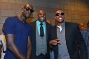 """(L-R) NBA player Kevin Garnett, NBA Hall of Fame member and Los Angeles Dodgers part owner Earvin """"Magic"""" Johnson and NBA player Paul Pierce appear at the MGM Grand Garden Arena for the Floyd Mayweather Jr. vs. Canelo Alvarez boxing match on September 14, 2013 in Las Vegas, Nevada."""