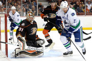 Daniel Sedin #22 of the Vancouver Canucks gets a rebound in front of Frederik Andersen #31 and Hampus Lindholm #47 of the Anaheim Ducks during the second period at Honda Center on November 9, 2014 in Anaheim, California.