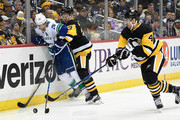 Brandon Sutter #20 of the Vancouver Canucks battles for the puck along the boards with Olli Maatta #3 of the Pittsburgh Penguins and Justin Schultz #4 in the third period during the game at PPG PAINTS Arena on November 22, 2017 in Pittsburgh, Pennsylvania.