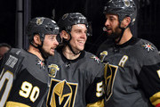 Tomas Tatar #90, Erik Haula #56 and Deryk Engelland #5 of the Vegas Golden Knights celebrate after Haula assisted Tatar on a goal against the Vancouver Canucks in the second period of their game at T-Mobile Arena on March 20, 2018 in Las Vegas, Nevada.
