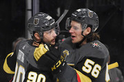 Tomas Tatar #90 and Erik Haula #56 of the Vegas Golden Knights celebrate after Haula assisted Tatar on a goal against the Vancouver Canucks in the second period of their game at T-Mobile Arena on March 20, 2018 in Las Vegas, Nevada.
