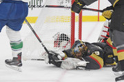 Marc-Andre Fleury #29 of the Vegas Golden Knights dives on the ice to block a shot by Jake Virtanen #18 of the Vancouver Canucks in the first period of their game at T-Mobile Arena on October 24, 2018 in Las Vegas, Nevada.