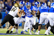 Benny Snell Jr #26 of the Kentucky Wildcats runs with the ball against the Vanderbilt Commodores at Commonwealth Stadium on October 20, 2018 in Lexington, Kentucky.