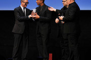 Director Peter Ramsey smiles as he collects the Vanity Fair International Award for Cinematic Excellence for the film 'Rise of the Guardians' from Pappi Corsicato as (L-R) producer Christina Steinberg, Jeffrey Katzenberg and executive producer Guillermo del Toro look on during a presentation at the 7th Rome Film Festival on November 13, 2012 in Rome, Italy.