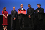 (L-R) Producer Christina Steinberg, Jeffrey Katzenberg, Pappi Corsicato and Guillermo del Toro look on as director Peter Ramsey (2R) collects the Vanity Fair International Award for Cinematic Excellence for the film 'Rise of the Guardians' during a presentation at the 7th Rome Film Festival on November 13, 2012 in Rome, Italy.