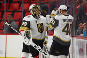 Marc-Andre Fleury #29 of the Vegas Golden Knights celebrates a 4-0 win over the Detroit Red Wings with Pierre-Edouard Bellemare #41 at Little Caesars Arena on March 8, 2018 in Detroit, Michigan.