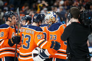 Ryan Nugent-Hopkins #93 and goaltender Cam Talbot #33 of the Edmonton Oilers celebrate their 4 - 3 victory against the Vegas Golden Knights at Rogers Place on April 5, 2018 in Edmonton, Canada.