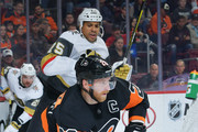 Claude Giroux #28 of the Philadelphia Flyers skates with the puck away from Ryan Reaves #75 of the Vegas Golden Knights at  the Wells Fargo Center on October 13, 2018 in Philadelphia, Pennsylvania.