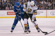 Daniel Sedin #22 of the Vancouver Canucks and Pierre-Edouard Bellemare #41 of the Vegas Golden Knights battle for control of the puck in NHL action on November, 16, 2017 at Rogers Arena in Vancouver, British Columbia, Canada.
