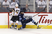 Paul Stastny #25 of the Winnipeg Jets battles for the puck with Cody Eakin #21 of the Vegas Golden Knights during the first period in Game Five of the Western Conference Finals during the 2018 NHL Stanley Cup Playoffs at Bell MTS Place on May 20, 2018 in Winnipeg, Canada.