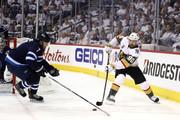 Tomas Tatar #90 of the Vegas Golden Knights is defended by Ben Chiarot #7 of the Winnipeg Jets during the first period in Game Two of the Western Conference Finals during the 2018 NHL Stanley Cup Playoffs at Bell MTS Place on May 14, 2018 in Winnipeg, Canada.