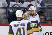 Tomas Tatar #90 is congratulated by his teammate Pierre-Edouard Bellemare #41 of the Vegas Golden Knights after scoring a first period goal against the Winnipeg Jets during the first period in Game Two of the Western Conference Finals during the 2018 NHL Stanley Cup Playoffs at Bell MTS Place on May 14, 2018 in Winnipeg, Canada.