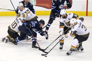 Ryan Carpenter #40, Cody Eakin #21, Deryk Engelland #5 and Brayden McNabb #3 of the Vegas Golden Knights converge on Paul Stastny #25 of the Winnipeg Jets in Game Five of the Western Conference Finals during the 2018 NHL Stanley Cup Playoffs on May 20, 2018 at Bell MTS Place in Winnipeg, Manitoba, Canada. (Photo by Jason Halstead /Getty Images) *** Local Caption *** Ryan Carpenter; Cody Eakin; Deryk Engelland; Brayden McNabb; Paul Stastny