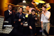 (L-R) Penn Jillette of the comedy/magic team Penn & Teller, entertainer Wayne Newton, singer Brandon Flowers of The Killers and frontman Dan Reynolds of Imagine Dragons perform at the Vegas Strong Benefit Concert at T-Mobile Arena to support victims of the October 1 tragedy on the Las Vegas Strip on December 1, 2017 in Las Vegas, Nevada.