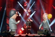 Major League Baseball player Bryce Harper (C) performs with Penn Jillette (L) and Teller of the comedy/magic team Penn & Teller at the Vegas Strong Benefit Concert at T-Mobile Arena to support victims of the October 1 tragedy on the Las Vegas Strip on December 1, 2017 in Las Vegas, Nevada.