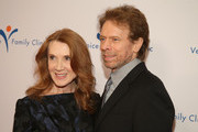 Editor Linda Bruckheimer (L) and producer Jerry Bruckheimer attend the Venice Family Clinic's Silver Circle Gala at Regent Beverly Wilshire Hotel on March 9, 2015 in Beverly Hills, California.