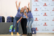Lauren Alaina and Bailee Madison interact with kids during Vera Bradley x Blessings In A Backpack event on August 28, 2019 in Nashville, Tennessee.
