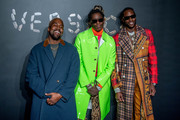 (L-R) Kanye West, Young Thug and 2 Chainz attend the the Versace fall 2019 fashion show at the American Stock Exchange Building in lower Manhattan on December 02, 2018 in New York City.